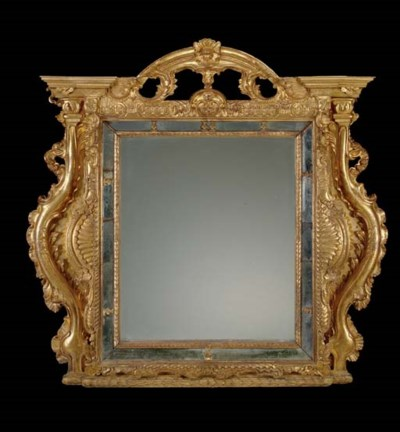 A SOUTH EUROPEAN GILTWOOD MIRR