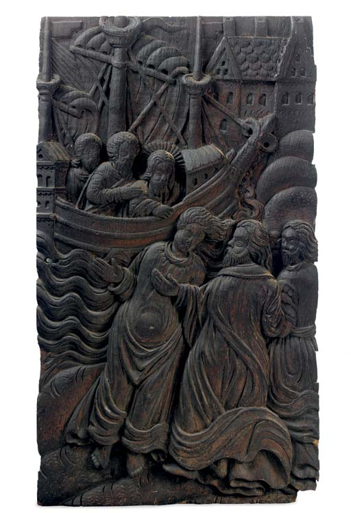 A CARVED OAK RELIEF OF FIGURES