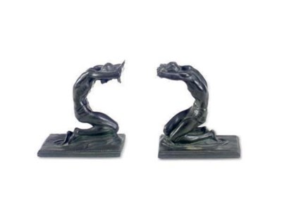 A PAIR OF BRONZE BOOKENDS,