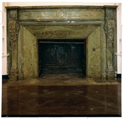 A FRENCH GREEN MARBLE FIRE SUR