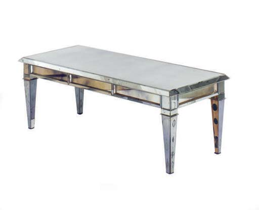 A MIRROR GLASS LOW TABLE,