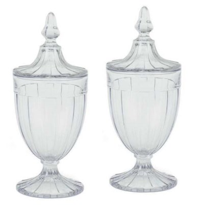A PAIR OF FLUTED GLASS URNS WI