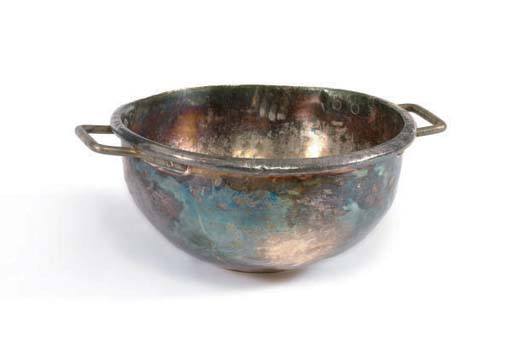 A LARGE TWO-HANDLED METAL CAUL
