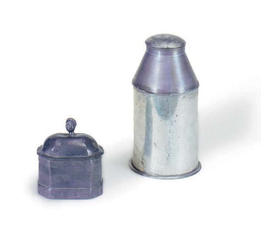 A LARGE METAL CANNISTER AND SM