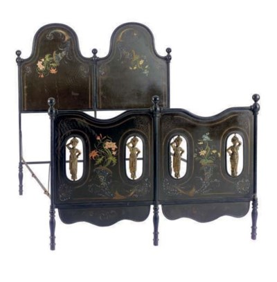 A PAINTED CAST IRON BED,