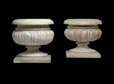 A pair of marble garden urns