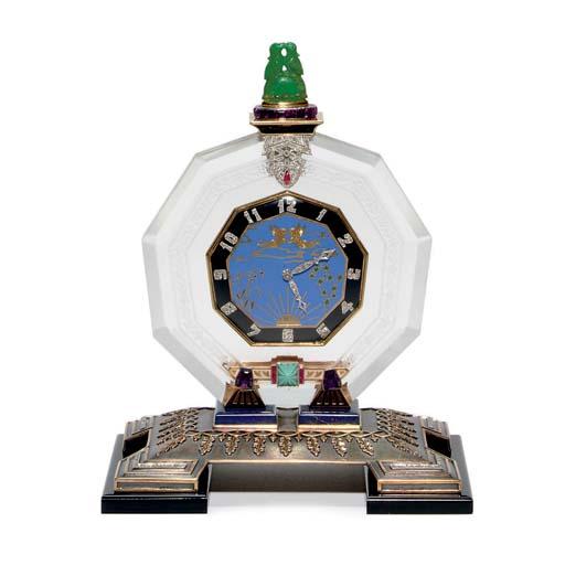 AN ART DECO MULTI-GEM AND DIAMOND DESK CLOCK, BY THE GROGAN COMPANY