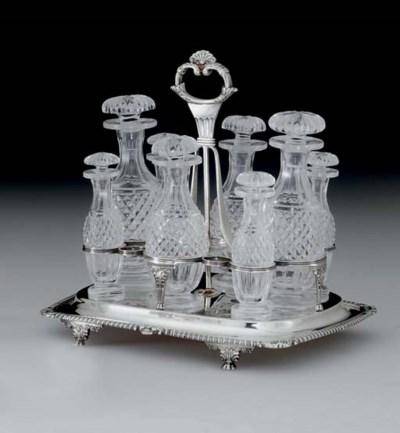 A REGENCY SILVER AND GLASS CRU