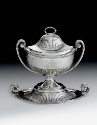 A GEORGE III SILVER SOUP TUREE