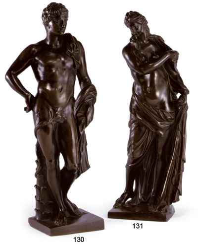 A PATINATED-BRONZE FIGURE OF A