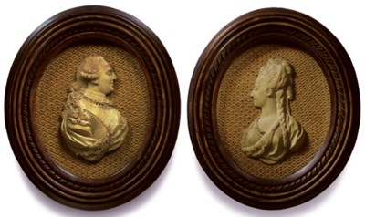 A PAIR OF TINTED-PLASTER RELIE