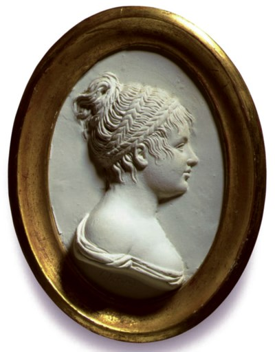AN OVAL PLASTER PROFILE RELIEF