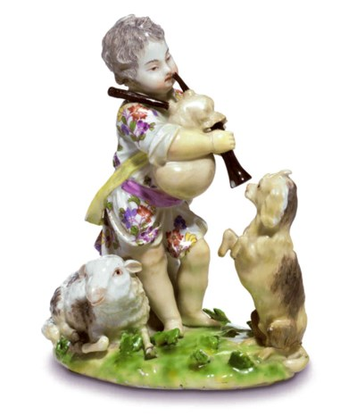 A MEISSEN GROUP OF A PUTTO GOA