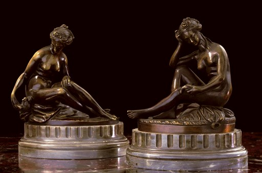 A PAIR OF PATINATED-BRONZE FIG