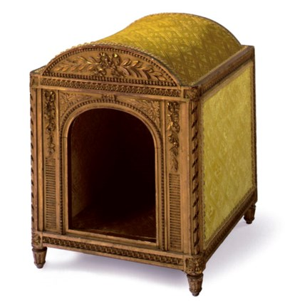 A FRENCH GILTWOOD DOG HOUSE