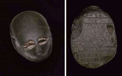 AN EGYPTIAN GRAYWACKE HUMAN-HE