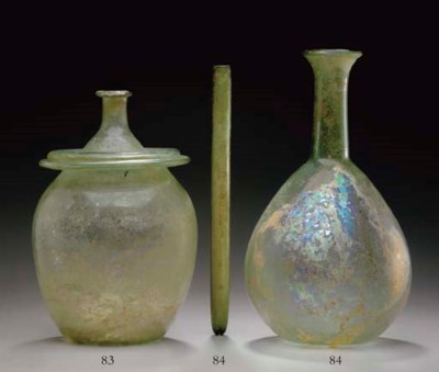 A ROMAN GLASS CINERARY URN AND