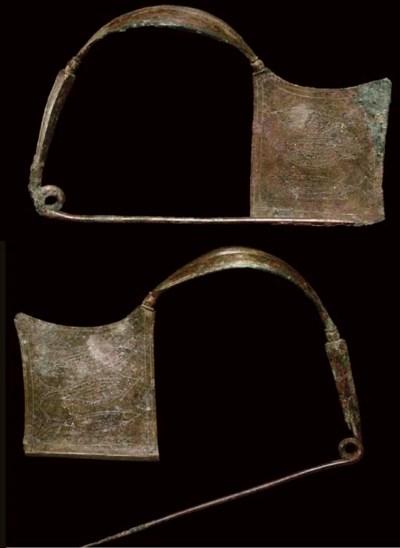 TWO GREEK BRONZE PLATE FIBULAE