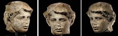 A GREEK LIMESTONE HEAD OF HERM