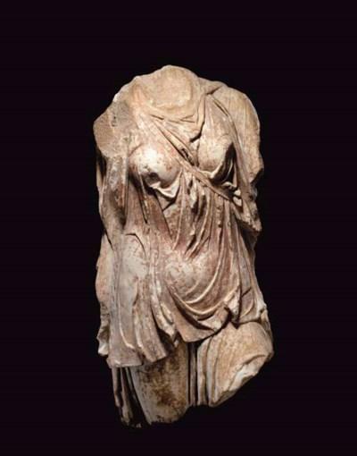 A GREEK MARBLE TORSO OF ARTEMI