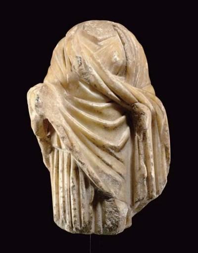 A ROMAN MARBLE TORSO OF HYGEIA