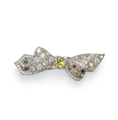 A COLORED DIAMOND BOW BROOCH