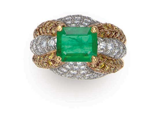AN EMERALD, COLORED DIAMOND AN
