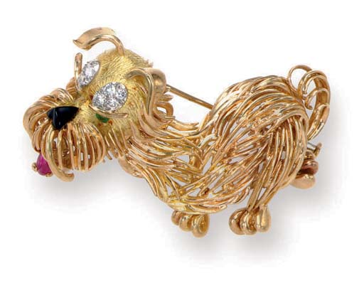 A MULTI-GEM AND GOLD DOG BROOC