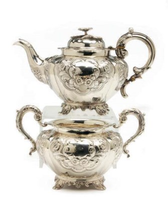 A VICTORIAN SILVER TEAPOT WITH