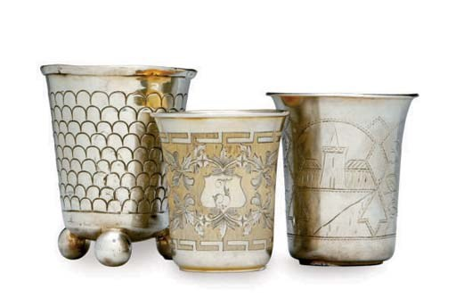 TWO RUSSIAN SILVER BEAKERS AND