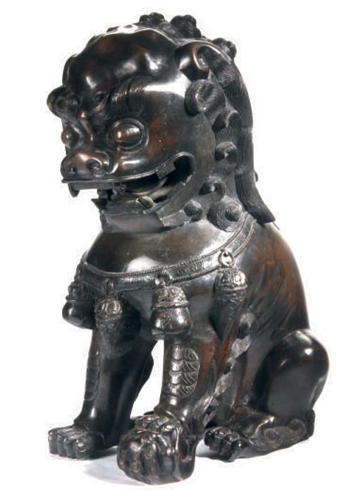 A BUDDHISTIC LION BRONZE,
