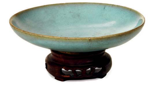 A CHINESE PALE BLUE GLAZED DIS