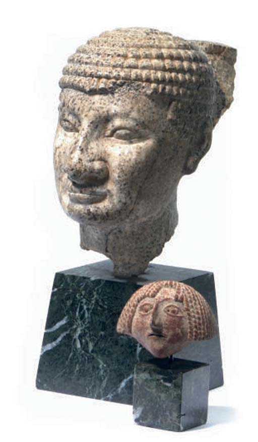 AN EGYPTIAN STYLE STONE HEAD O