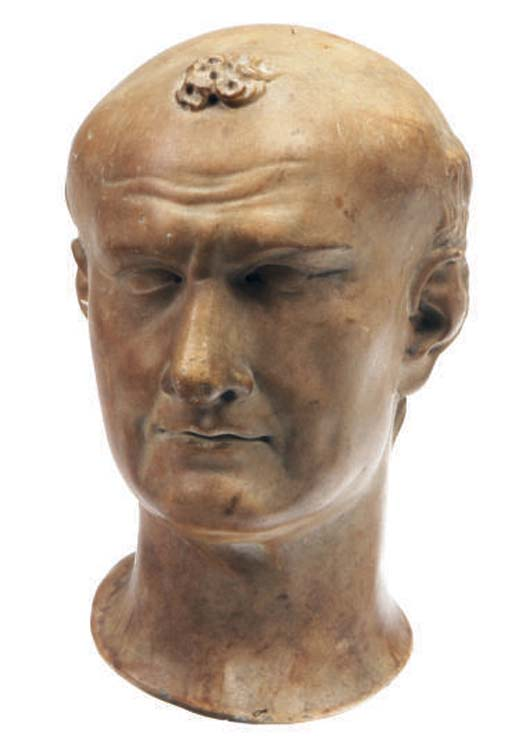 A ROMAN STYLE MARBLE HEAD OF T
