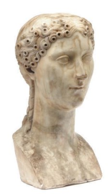 A ROMAN STYLE MARBLE BUST OF A