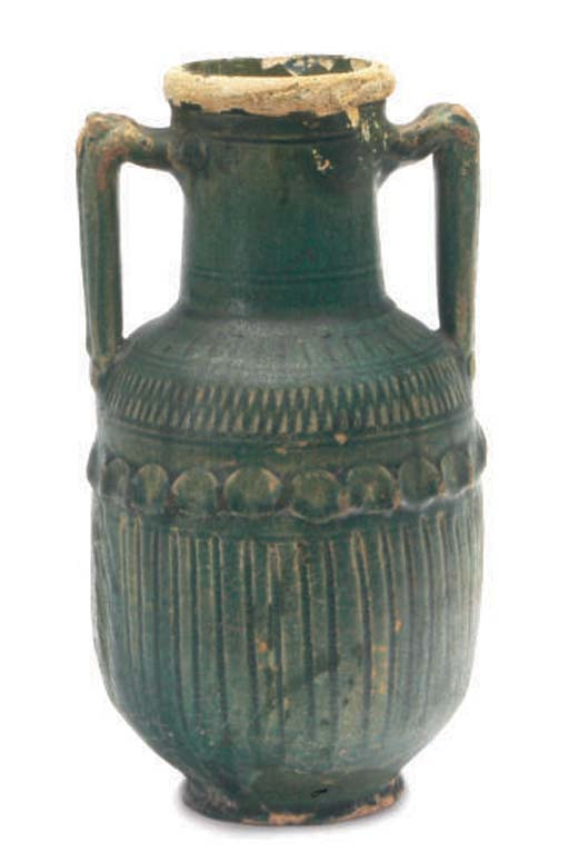 A PARTHIAN GREEN-GLAZED POTTER