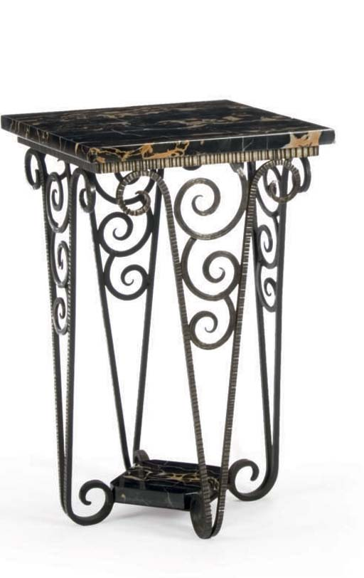 A WROUGHT IRON SIDE TABLE WITH