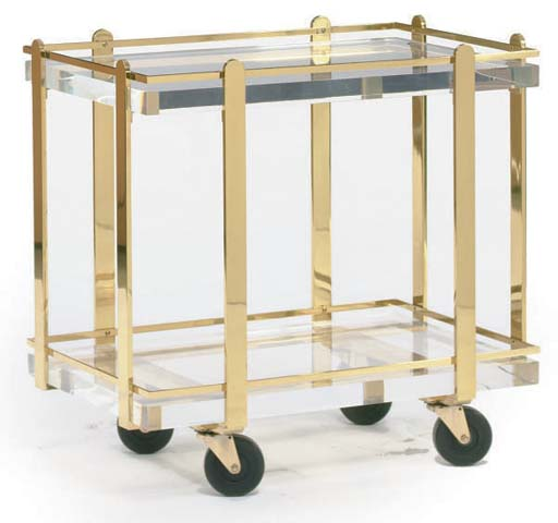 A LUCITE AND BRASS TWO TIER BA