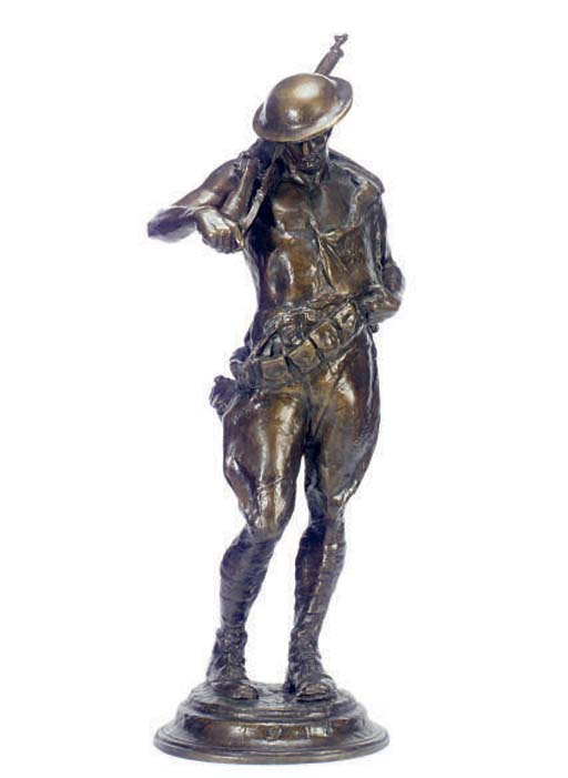 A PATINATED BRONZE FIGURE OF A