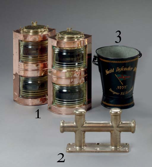 A pair of double lens copper and brass running lights