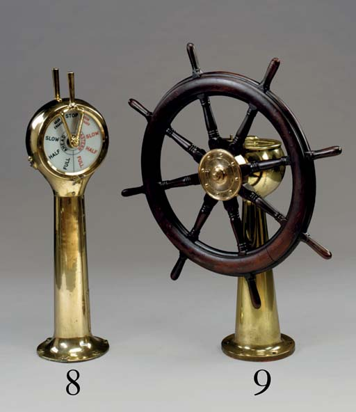 A double handled brass engine telegraph
