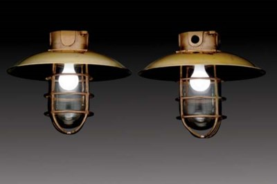 A pair of large ceiling mounte