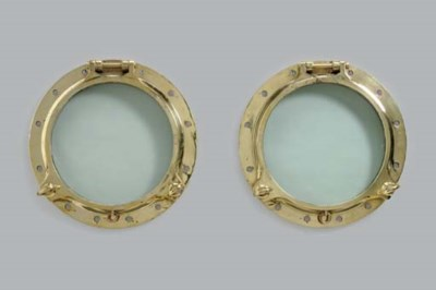 A pair of brass ship's porthol