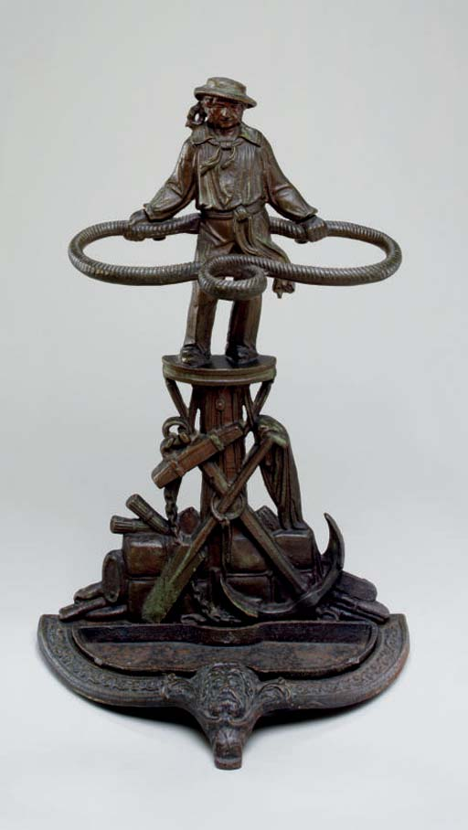 A cast iron umbrella stand in the form of Jack Tar