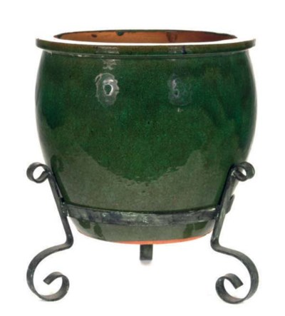 A GREEN GLAZED POTTERY JARDINI