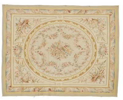 AN AUBUSSON STYLE CARPET,