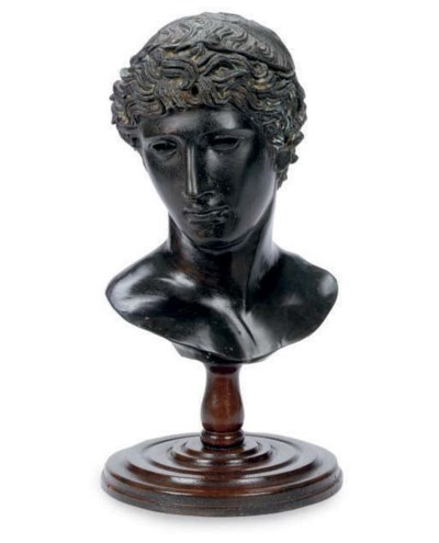 A PATINATED BRONZE BUST OF A Y