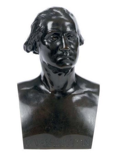 A PATINATED BRONZE BUST OF GEO