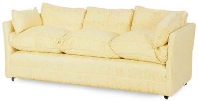 A YELLOW UPHOLSTERED SOFA,