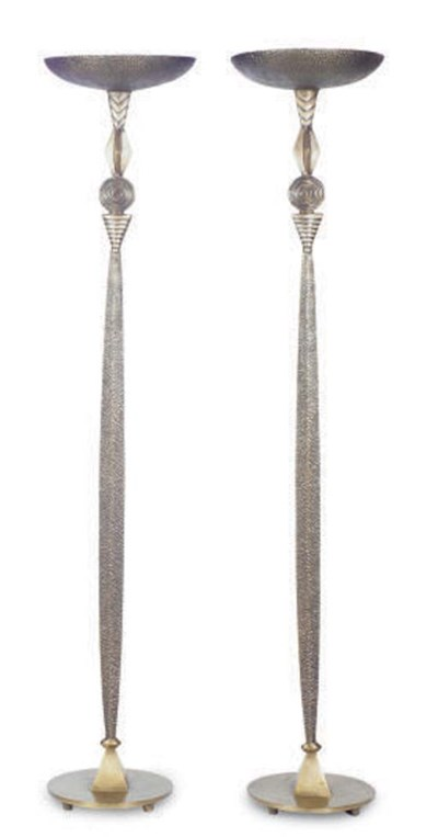 A PAIR OF PATINATED BRONZE TOR